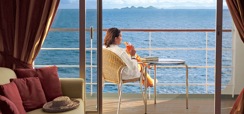 Passenger Lounging on a Balcony Cabin on an MSC Cruise Ship