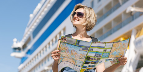 Woman holding map in front of ship